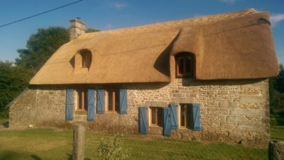 RJ Matravers Thatched house with wooden shutters