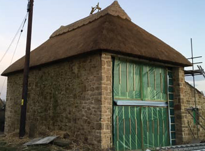 RJ Matravers Thatched building